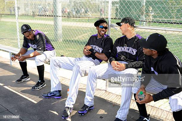 Colorado Rockies players form left Chris Nelson Dexter Fowler Carlos Gonzalez and Eric Young Jr joke from the dugout during spring training at Salt...