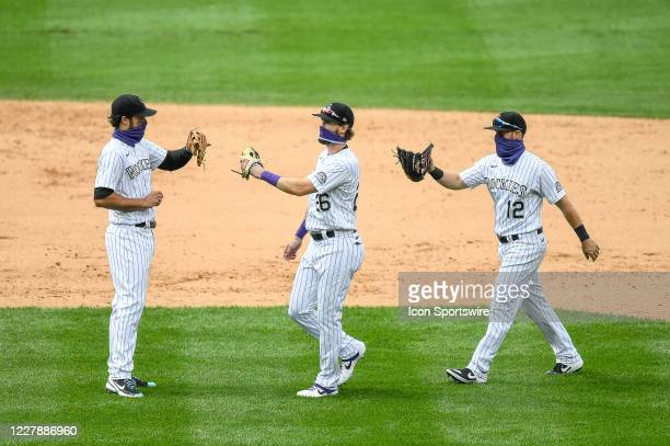 Colorado Rockies players, from left, third baseman Nolan Arenado , left fielder David Dahl , and second baseman Chris Owings celebrate a win over the...