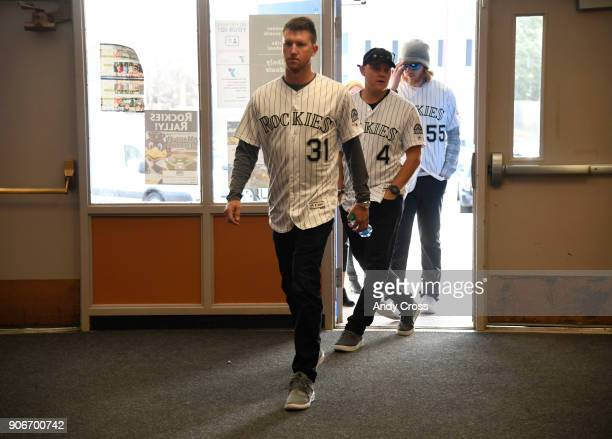 Colorado Rockies players from left to right Kyle Freeland Pat Valaika and Jon Gray enter Holm Elementary School for the Colorado Rockies Caravan Make...