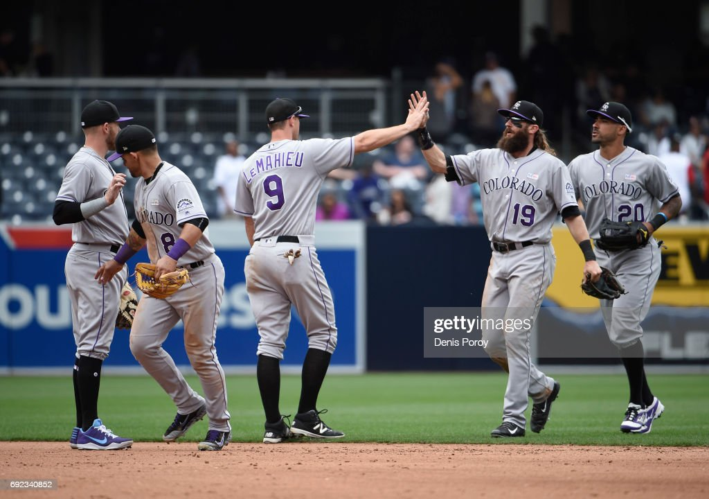 Colorado Rockies players high five after beating the San Diego Padres 3-1 in a baseball game at PETCO Park on June 4, 2017 in San Diego, California.