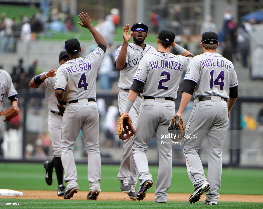 Colorado Rockies players high-five after beating the San Diego Padres 2-1 in a baseball game at Petco Park on April 14, 2013 in San Diego, California.