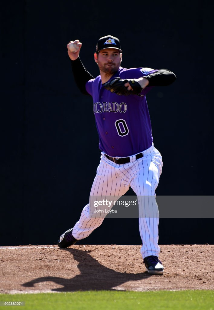 Colorado Rockies relief pitcher Adam Ottavino (0) delivers a pitch during workouts on February 21, 2018 at Salt River Fields at Talking Stick in Scottsdale, Arizona.