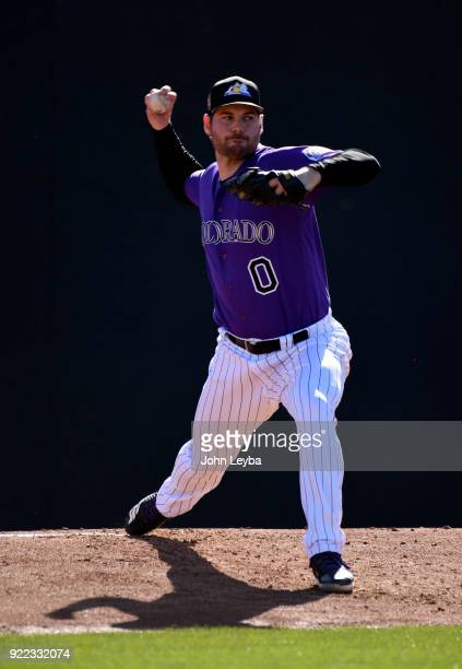 Colorado Rockies relief pitcher Adam Ottavino delivers a pitch during workouts on February 21 2018 at Salt River Fields at Talking Stick in...