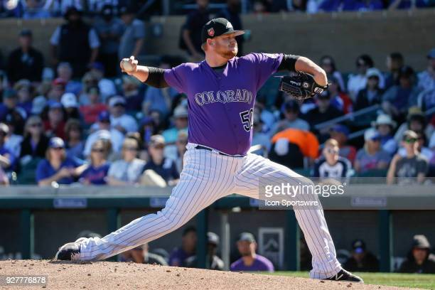 Colorado Rockies relief pitcher Brooks Pounders throws a pitch during the spring training baseball game between the Chicago Cubs and the Colorado...