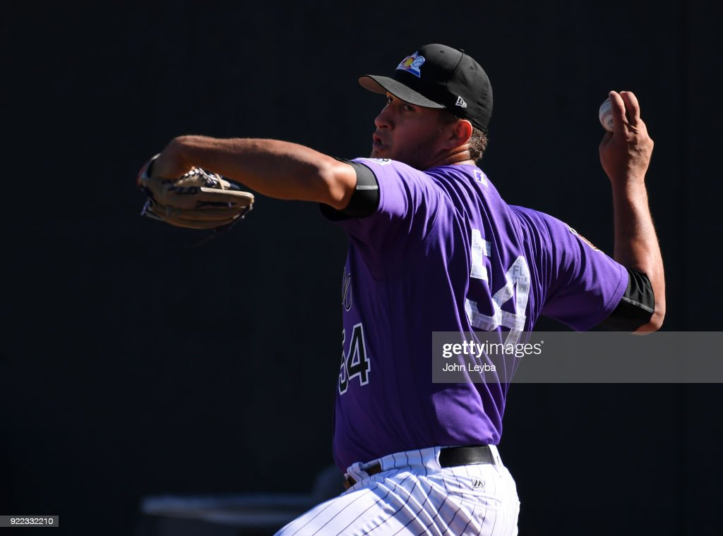 Colorado Rockies relief pitcher Carlos Estevez (54) delivers a pitch during workouts on February 21, 2018 at Salt River Fields at Talking Stick in Scottsdale, Arizona.