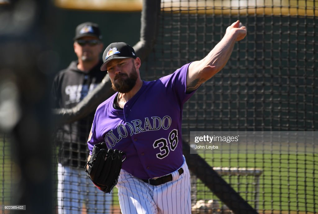 Colorado Rockies relief pitcher Mike Dunn (38) delivers a pitch during batting practice on February 21, 2018 at Salt River Fields at Talking Stick in Scottsdale, Arizona.