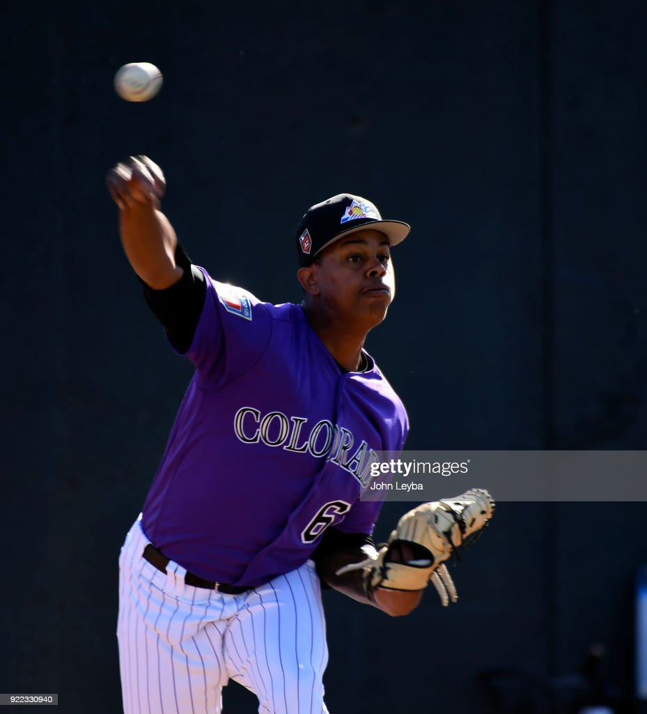 Colorado Rockies relief pitcher Yency Almonte (62) delivers a pitch during workouts on February 21, 2018 at Salt River Fields at Talking Stick in Scottsdale, Arizona.