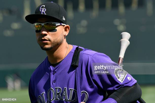 Colorado Rockies right fielder Carlos Gonzalez heads to the dugout for the game against the Los Angeles Dodgers at Salt River Fields on February 28...