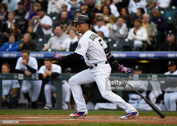 Colorado Rockies right fielder Carlos Gonzalez hits a single in the first inning against the San Diego Padres at Coors Field April 09 2016