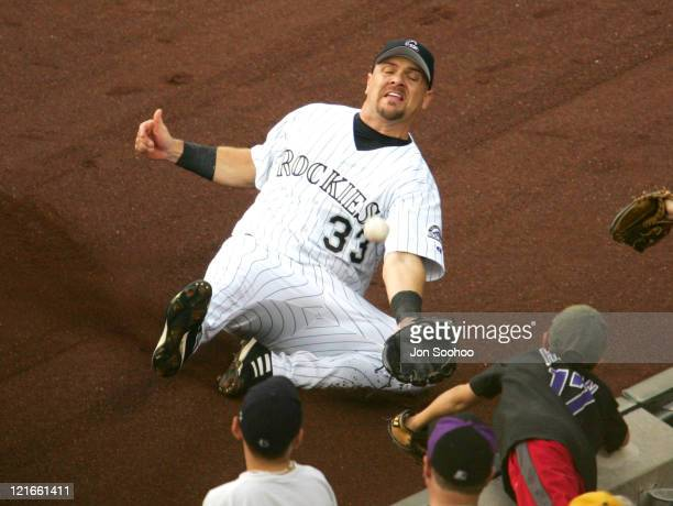 Colorado Rockies right fielder Larry Walker can't make catch during the game against the Colorado Rockies at Coors Field in Denver, Colorado on July...