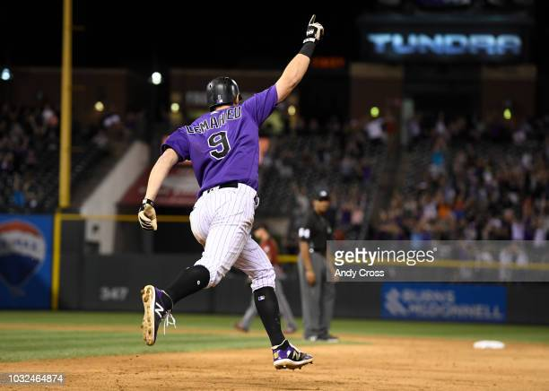 Colorado Rockies second baseman DJ LeMahieu celebrates rounding first base on a walkoff home run against the Arizona Diamondbacks relief pitcher...