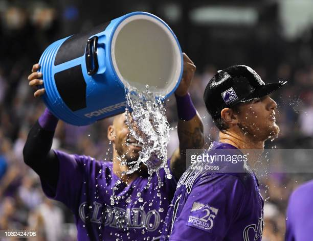 Colorado Rockies second baseman DJ LeMahieu doused by teammate Colorado Rockies first baseman Ian Desmond after hitting a walkoff home run against...