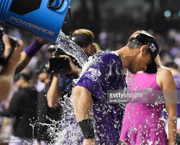 Colorado Rockies second baseman DJ LeMahieu gets doused by teammates after hitting a walkoff home run against the Arizona Diamondbacks relief pitcher...