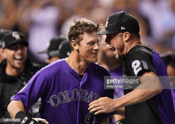 Colorado Rockies second baseman DJ LeMahieu left celebrates with Colorado Rockies pitcher Kyle Freeland and other teammates after hitting a walkoff...