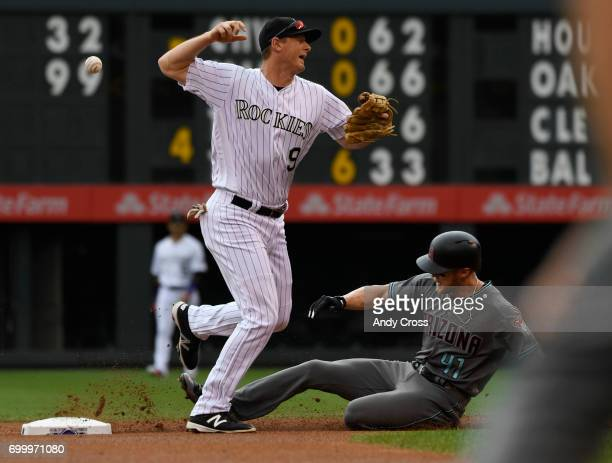 Colorado Rockies second baseman DJ LeMahieu loses the grip on the ball and can't complete the double play to first but does get Jeremy Hazelbaker #41...