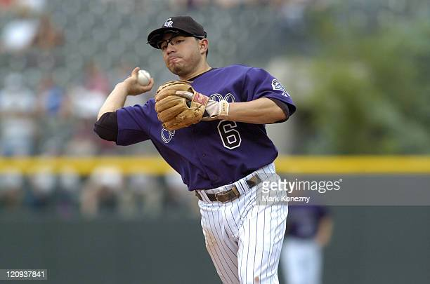 Colorado Rockies second baseman Omar Quintanilla makes a play for an out during a game against against the Kansas City Royals at Coors Field in...