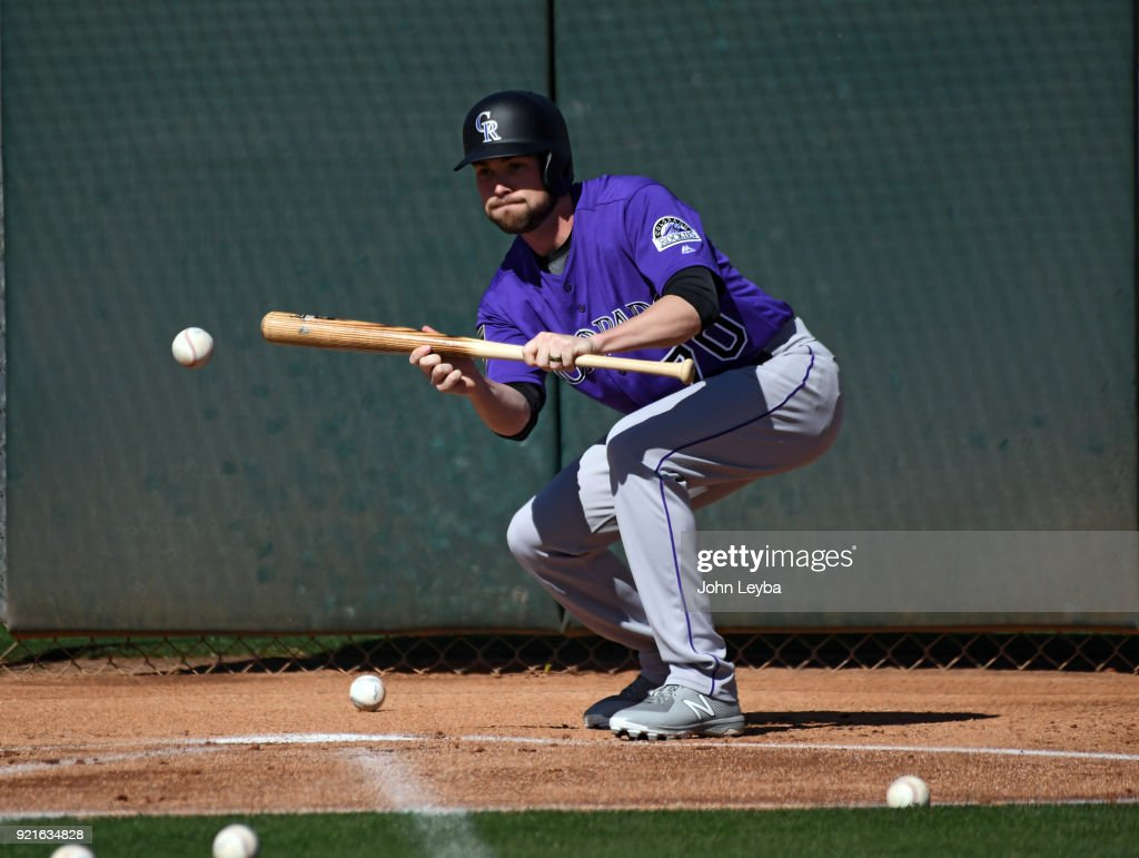 Colorado Rockies Shabne Broyles (70) practices bunting in drills during the teams workout on February 20, 2018 at Salt River Fields at Talking Stick in Scottsdale, Arizona.