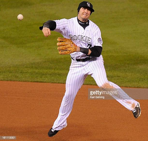 Colorado Rockies short stop Troy Tulowitzki throws out Philadelphia Phillies' center fielder Shane Victorino for the first out of the top of the...