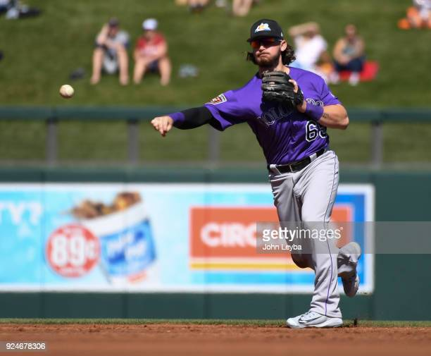 Colorado Rockies shortstop Brendan Rodgers makes a throw to first base for an out during the first inning against the Arizona Diamondbacks on...