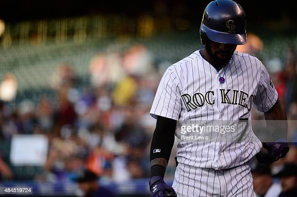 Colorado Rockies shortstop Jose Reyes warms up while waiting on deck during the first inning August 19 2015 at Coors Field Colorado Rockies face off...