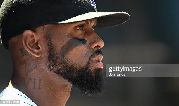 Colorado Rockies shortstop Jose Reyes watches the scoreboard before heading to the field against the Seattle Mariners August 5 2015 at Coors Field