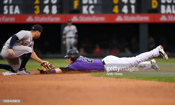 Colorado Rockies shortstop Trevor Story gets tagged out by Houston Astros second baseman Jose Altuve on a steal in the second inning at Coors Field...