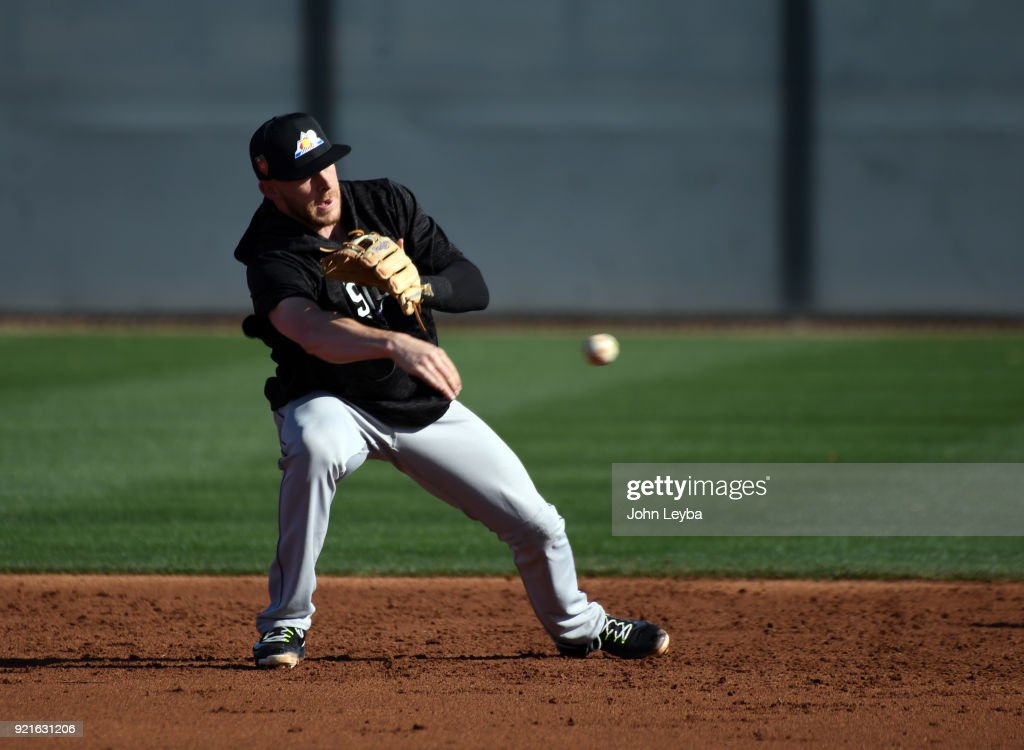 Colorado Rockies shortstop Trevor Story (27) throws over to second base during double play drills on February 20, 2018 at Salt River Fields at Talking Stick in Scottsdale, Arizona.