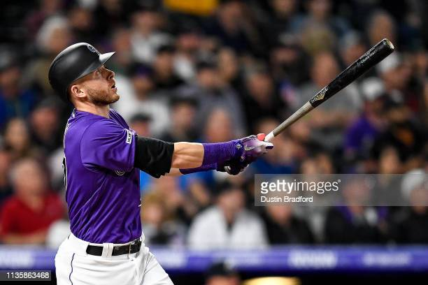 Colorado Rockies shortstop Trevor Story watches the flight of a fifth inning 3run homerun against the Atlanta Braves at Coors Field on April 8 2019...