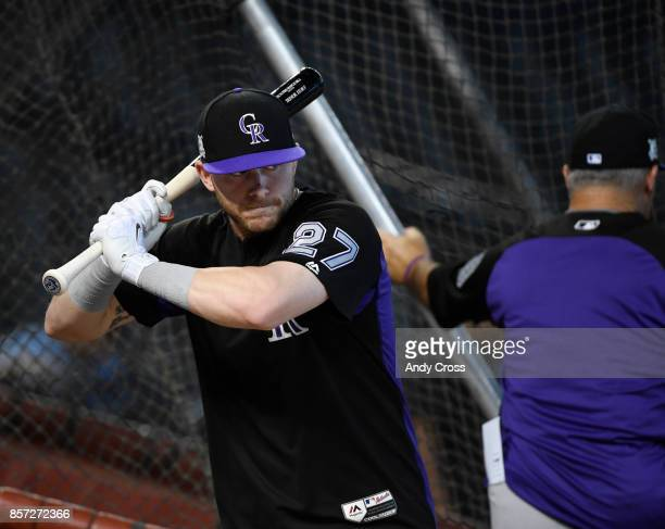 Colorado Rockies shortstop Trevor Story works on his swing outside of the cage during batting practice at Chase Field October 03 2017 The Colorado...