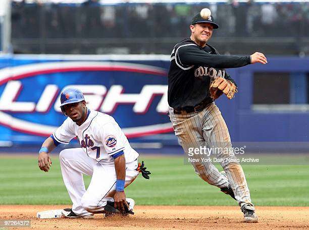 Colorado Rockies' shortstop Troy Tulowitzki tries to turn a double play after forcing New York Mets' Jose Reyes out at second in the fourth inning at...