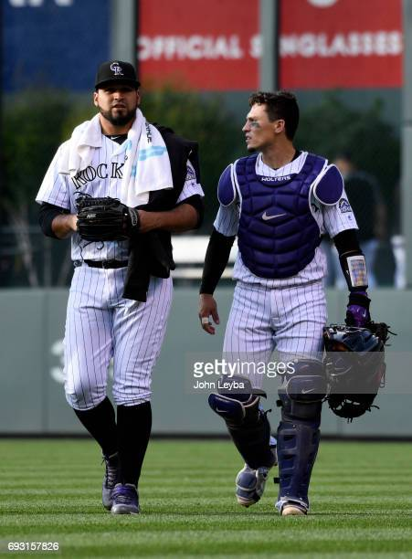 Colorado Rockies starting pitcher Antonio Senzatela and Colorado Rockies catcher Tony Wolters walks from the bullpen to the dugout for the start of...