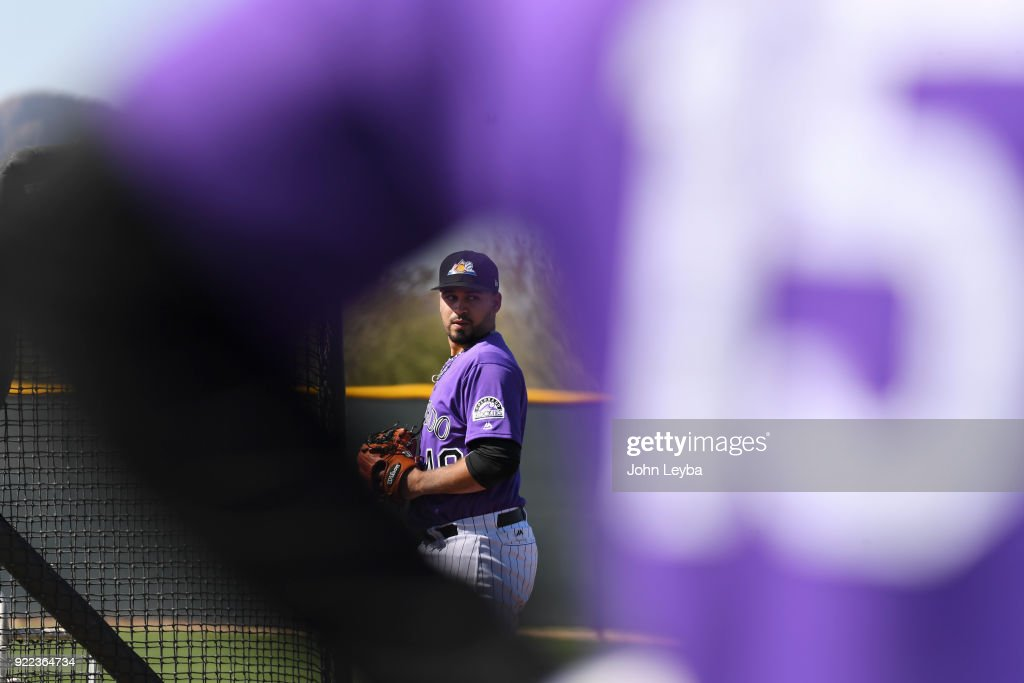 Colorado Rockies starting pitcher Antonio Senzatela (49) delivers a pitch during batting practice on February 21, 2018 at Salt River Fields at Talking Stick in Scottsdale, Arizona.