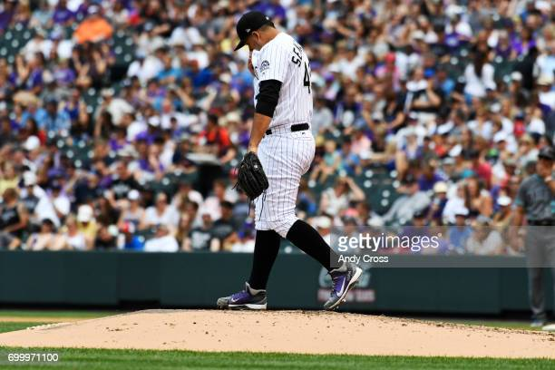 Colorado Rockies starting pitcher Antonio Senzatela takes a moment to collect himself after allowing a threerun home run from Arizona Diamondbacks...
