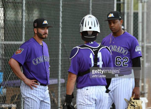 Colorado Rockies starting pitcher Chad Bettis talks with catcher Tony Wolters after his pitching session during the teams workout on February 19 2018...