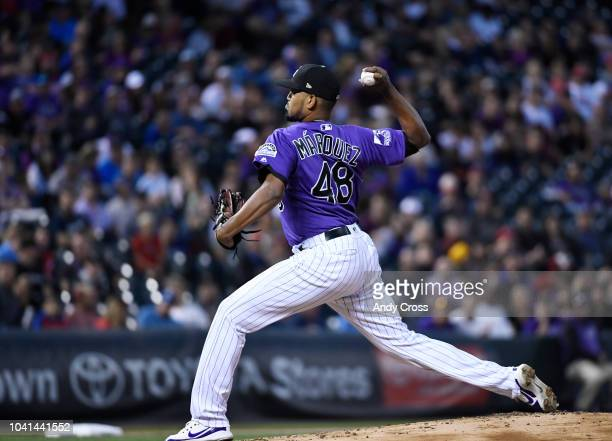 Colorado Rockies starting pitcher German Marquez throws and strikes out Philadelphia Phillies center fielder Roman Quinn in the 2nd inning at Coors...