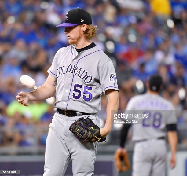 Colorado Rockies starting pitcher Jon Gray bounces the rosin bag around in the fourth inning against the Kansas City Royals at Kauffman Stadium in...