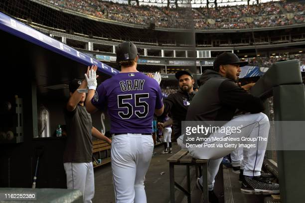 ,Colorado Rockies starting pitcher Jon Gray gets hi 5's after laying down a sacrifice bunt as the Colorado Rockies take on the Cincinnati Reds at...