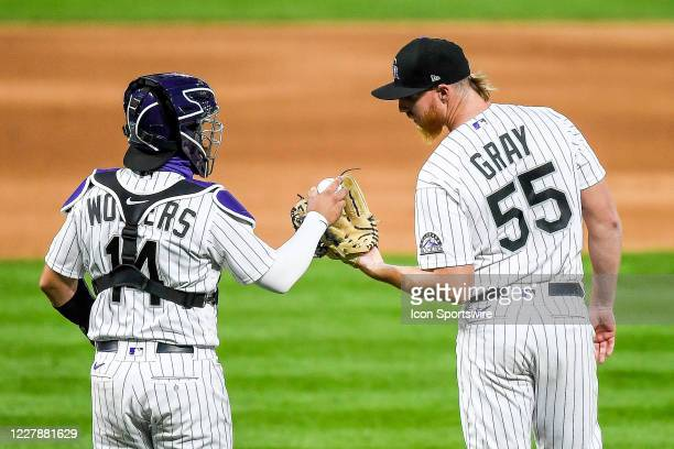 Colorado Rockies starting pitcher Jon Gray has a word with right fielder Charlie Blackmon during the Rockies 2020 home opener against the San Diego...