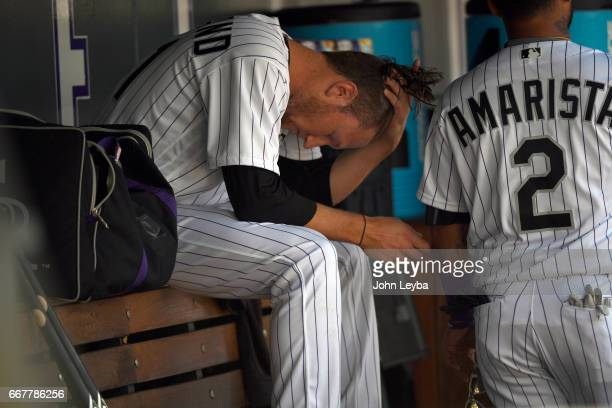 Colorado Rockies starting pitcher Kyle Freeland sits on the bench in the dugout dejected after he was pulled from the game by Colorado Rockies...
