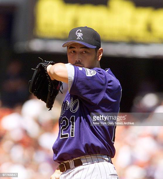 Colorado Rockies' starting pitcher Masato Yoshii shows signs of a rough outing at Shea Stadium against his former team the New York Mets He was...