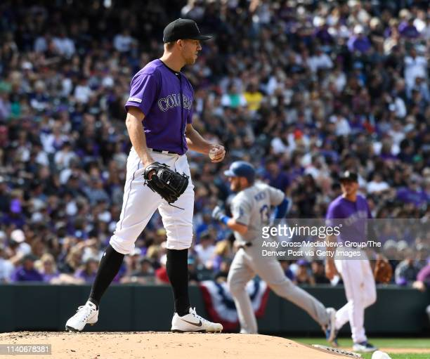 Colorado Rockies starting pitcher Tyler Anderson on the mound as Los Angeles Dodgers second baseman Max Muncy heads home on a solo home run against...