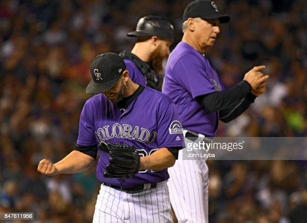 Colorado Rockies starting pitcher Tyler Chatwood pounds his fist in his glove after getting pulled by manager Bud Black in the sixth inning against...