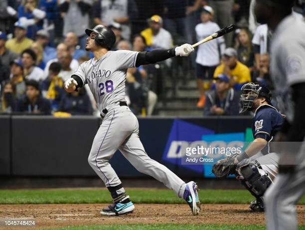 Colorado Rockies third baseman Nolan Arenado hits a sac fly in the 9th inning to score Colorado Rockies second baseman Garrett Hampson to tie the...