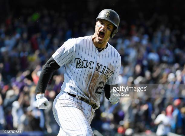 Colorado Rockies third baseman Nolan Arenado reacts after hitting a tworun home run against Washington Nationals relief pitcher Erick Fedde in the...