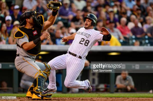 Colorado Rockies third baseman Nolan Arenado runs to attempt to score a run in the fifth inning as Pittsburgh Pirates catcher Francisco Cervelli...