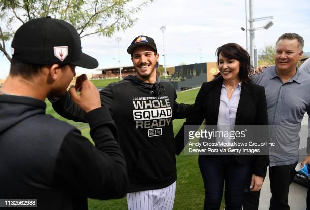 Colorado Rockies third baseman Nolan Arenado send from left greets his cousin Colorado Rockies top prospect and cousin Josh Fuentes left as Nolan's...