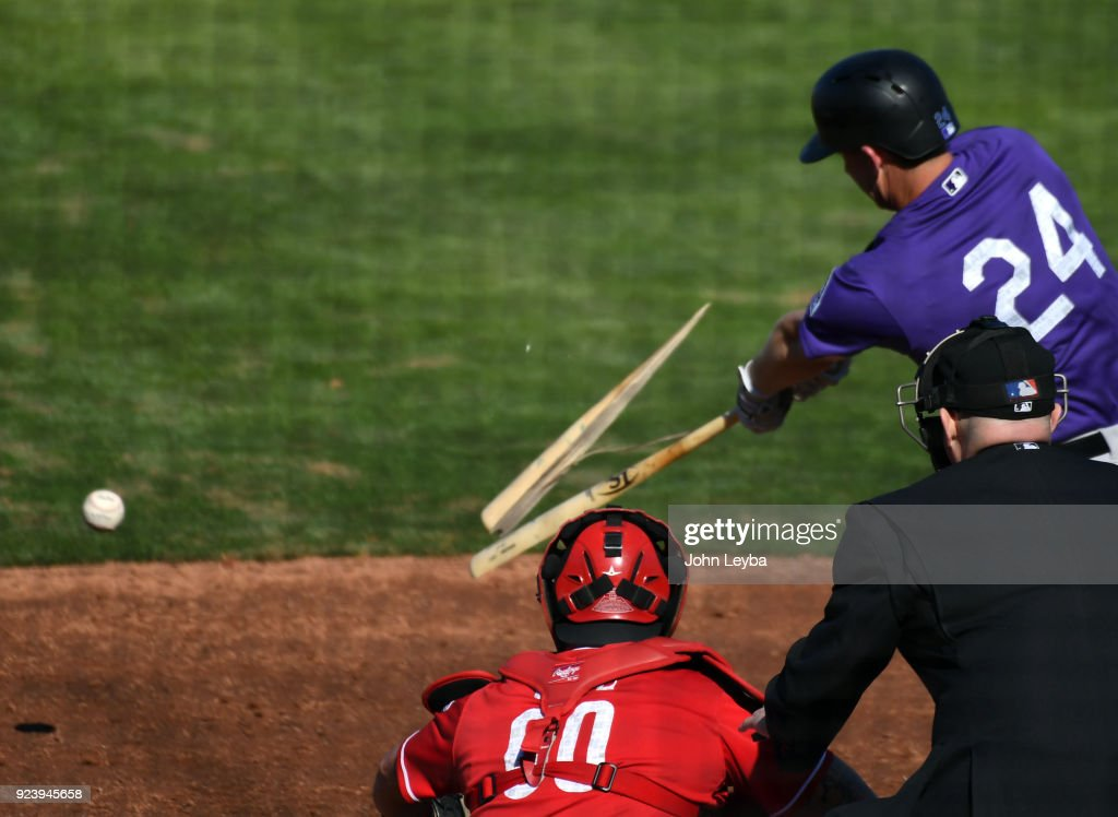 Colorado Rockies third baseman Ryan McMahon (24) breaks his bat on a pitch for a single against the Cincinnati Reds in the seventh inning on February 24, 2018 at Goodyear Ballpark.
