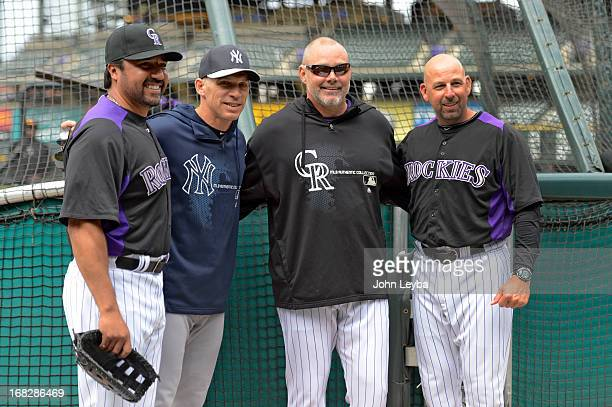 Colorado Rockies Vinny Castilla, New York Yankees manager Joe Girardi, Dante Bichette and Walt Weis all pose for a photo during batting practice May...