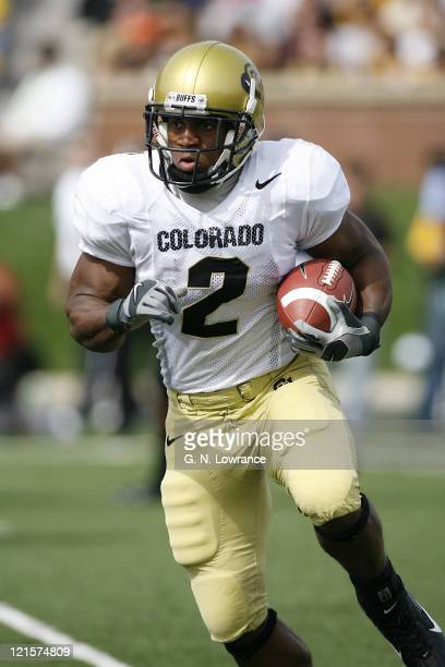 Colorado running back Hugh Charles runs for yardage during action between the Colorado Buffaloes and Missouri Tigers at Faurot Field in Columbia,...