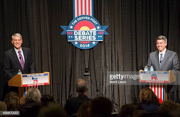 October 7: Colorado Senator Mark Udall and challenger, Representative Cory Gardner laugh while being asked questions from facilitator Chuck Plunkettt...